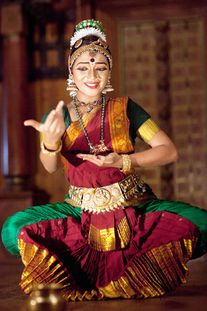 FORT COCHIN, INDIA - JANUARY 21, 2016: Indian girl dancing traditional Indian dance Kuchipudi in Kerala Kathakali Center Editorial