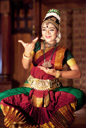 COCHIN, INDIA - JANUARY 21, 2016: Beautiful Indian girl dancing Indian dance Kuchipudi in Fort Cochin, Kerala. Editorial
