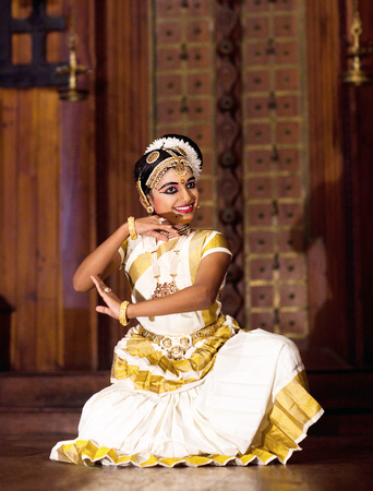 Indian girl dancing Mohinyattam (Dance of enchantress) on January 21, 2016 in Fort Cochin, South India. Mohiniyattam is traditional South Indian dance from Kerala Editorial