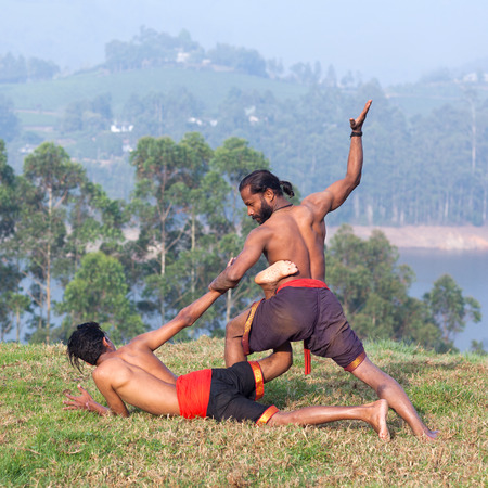 Indian fighters performing Adi Thada (Hand Combat) during Kalaripayattu Marital art demonstration in Kerala, South India