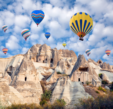 Colorful hot air balloons flying over the valley in Cappadocia, Anatolia, Turkey