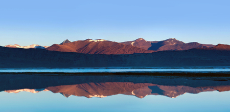 Panorama of Tso Kar salt water lake with reflection in Ladakh, North India. Tso Kar located in Rupsa valley, nearly 240 km southeast of Leh at a height of around 4,500 m and 28 km long.