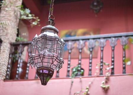 Traditional Moroccan glass copper lamp in oriental riad interior. Morocco, North Africa