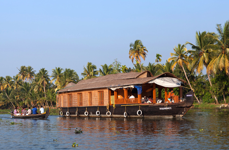 ALLEPPEY, INDIA - NOVEMBER 7, 2016: Tourists on houseboat floating on backwaters in Kerala State, South India Editorial