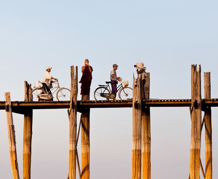 AMARAPURA, MANDALAY DIVISION, MYANMAR - JANUARY 13, 2011: People walking on famous U-Bein teak bridge in Amarapura, Myanmar.