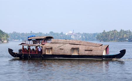 KERALA, INDIA - NOVEMBER 5, 2016: Houseboat floating on backwaters in Kerala, South India