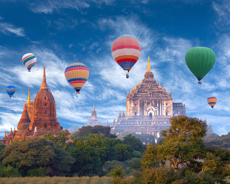 Thatbyinnyu Temple and colorful hot air balloons flying over Bagan Archaeological zone, Mandalay division, Myanmar