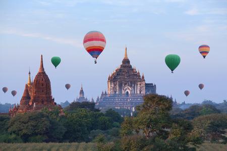 Famous ancient Thatbyinnyu Temple and hot air balloons flying over Bagan, Mandalay division, Myanmar