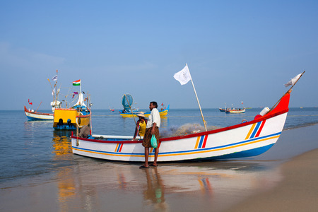 ALLEPPEY, INDIA - NOVEMBER 7, 2016: Indian fishermen catching fish for food in wooden boats in Arabian sea, Kerala state