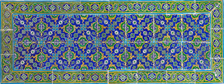 Ancient colorful tiles with oriental pattern close up background Standard-Bild