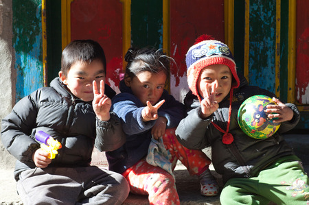 NAMCHE BAZAAR, NEPAL - JANUARY 19, 2017: Nepalese children poses for a photo on the street