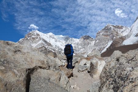 Tourist walking on the road to Everest Base camp in Sagarmatha National Park, Nepal Himalaya