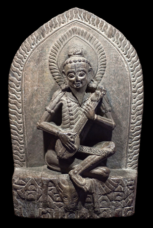 Narada - heavenly musician. Ancient Nepalese stone carving. Nepal, 15-16th century. In Hindu traditions Narada famous as a traveling musician and storyteller, who carries news and enlightening wisdom. He appears in a number of Hindu texts, notably the Mah Editorial