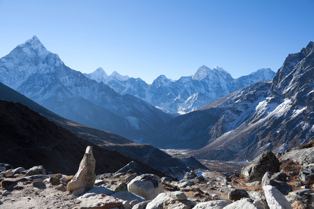 Ama Dablam mount view from mountain pass on the way to Everest Base camp in Sagarmatha National Park, Nepal Himalaya