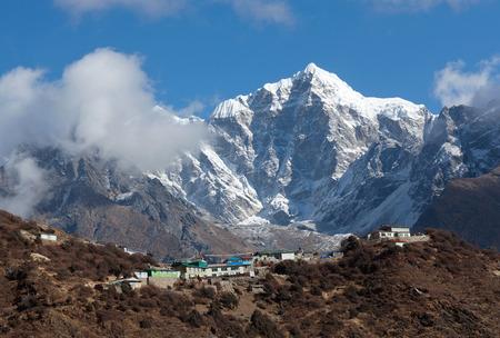 Mount Thamserku and village on the way to Everest base camp, Khumbu, Sagarmatha National Park, Nepal Himalaya