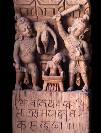 Ancient Nepalese wooden carving at the column in palace on Durbar square in Patan, Kathmandu valley, Nepal Reklamní fotografie