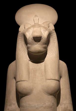Statue of goddess Bastet, Bast or Sakhmet with lioness head and solar disk. In Egyptian mythology, she was a warrior and goddess of love and healing Foto de archivo