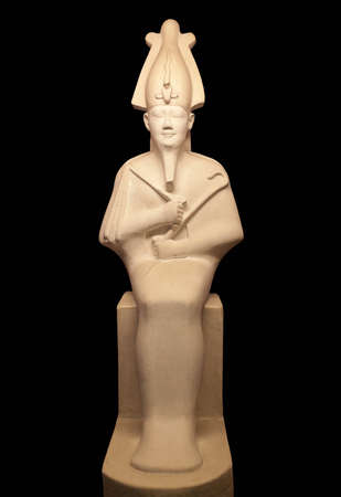 Statue of Osiris isolated on black background. He was son of Ra, lord of the dead and rebirth, god of fertility, agriculture, afterlife in ancient Egypt.