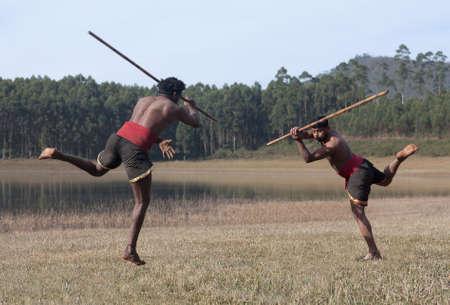 Indian fighters with bamboo stick performing Kalaripayattu Marital art demonstration in Kerala state, South India