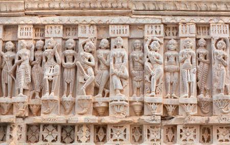 Ancient bas-relief with Apsaras at famous ancient Jagdish Temple in Udaipur, Rajasthan, India. It has been in continuous worship since 1651.
