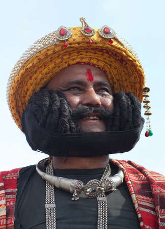 BIKANER, INDIA - JANUARY 11, 2019: Indian man presenting his famous long mustache during Camel Festival in Rajasthan
