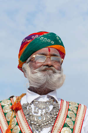 BIKANER, INDIA - JANUARY 11, 2019: Indian Rajasthani handsome man in national clothes poses for a photo during Camel Festival in Rajasthan state