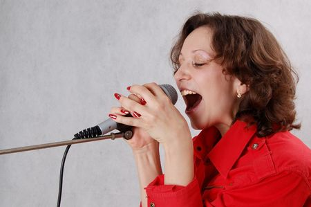 singing woman with microphone photo