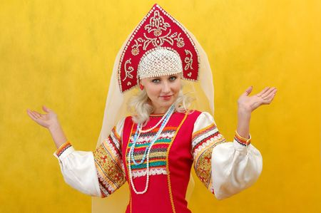 a beautifull woman in a folk russian dress photo