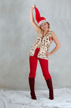 young woman cute and funny looking in a santa clothers photo