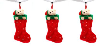 teddy bear christmas: three christmas boots filled with gifts