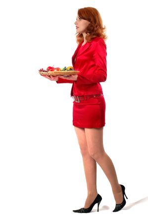 lady dressed in a red business suit with tray and fruits on it