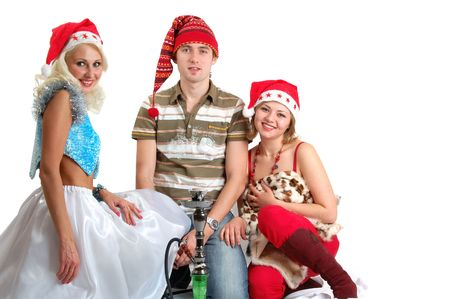young man in red cap surrounded by women in christmas hats Stock Photo - 2696833