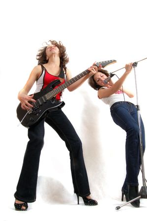 two beautiful expressive women with microphone and guitar photo