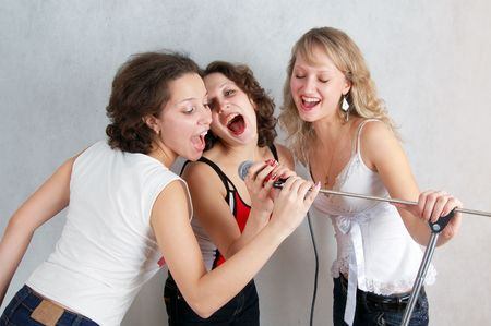 beautiful expressive women with microphone and guitar Stock Photo