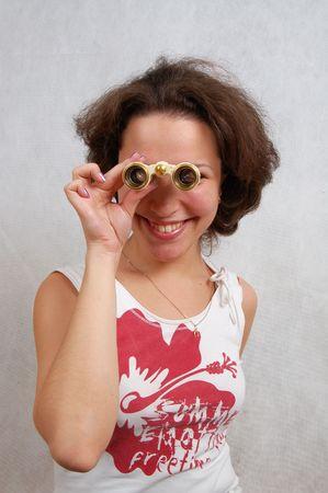 laughing young beautiful woman looking through binoculars Stock Photo - 2514190