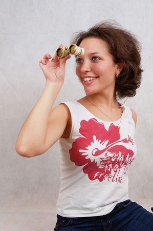 laughing young beautiful woman looking through binoculars Stock Photo - 2514178