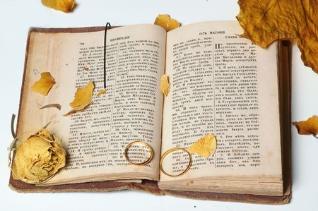 rings and faded flower on the old holy bible photo