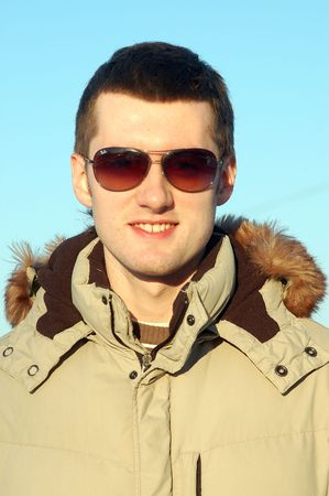 young man in winter clothers with sunglasses Stock Photo - 2514148