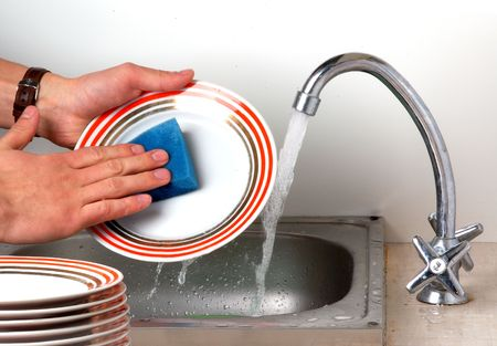 man hands, washing the dishes at the kitchen photo