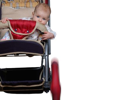 baby, sitting in a carriage, as if he has participate in a rally or pursuit Stock Photo