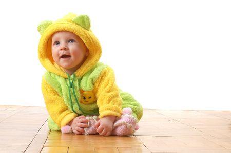 liitle baby in combination sitting on wooden floor 写真素材
