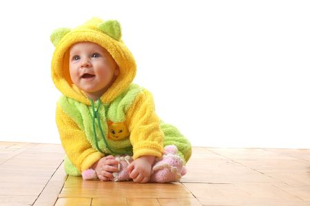 liitle baby in combination sitting on wooden floor Stock Photo