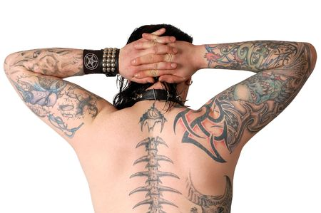 back of a man covered with lot of tatoos