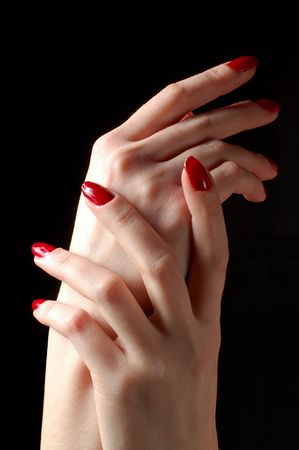 woman hands caressing one another im the dark photo