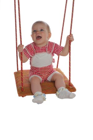 happy little kid playing with swing, isolated on white background