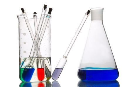 a lot of retorts with liquids of different colour, white background