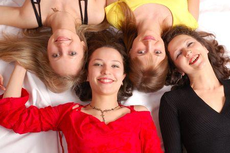 Happy birthday. Four girls friends have fun photo