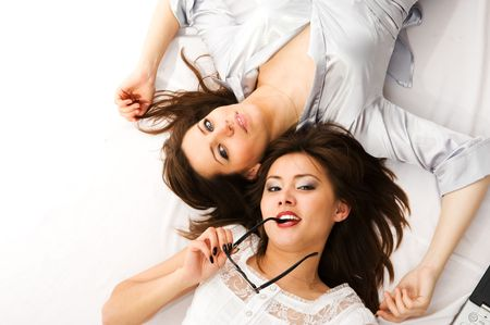 Close- up.Two businesswomen have fun lying on the floor Stock Photo - 3279158