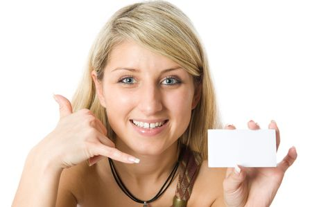 Closeup portrait of a beautiful blonde girl holding a white card. Isolated on white background photo