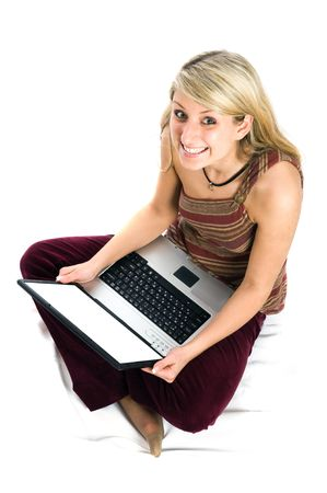 Beautiful girl with blonde hair using a laptop computer and smile. Shot with Nikon D3. photo